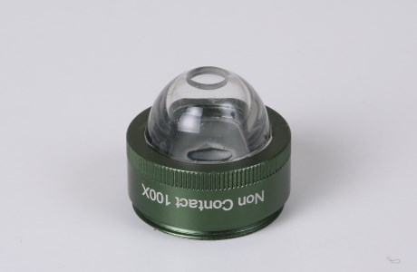 Immersion fluid non-contact adapter for 100x lens